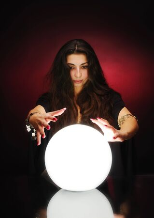 presage: Fortuneteller with magic sphere Stock Photo