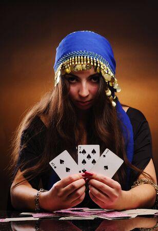 tell fortune: Fortuneteller at work