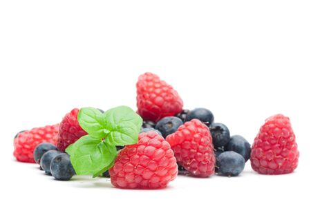 organic raspberry: Isolated fresh berries with mint
