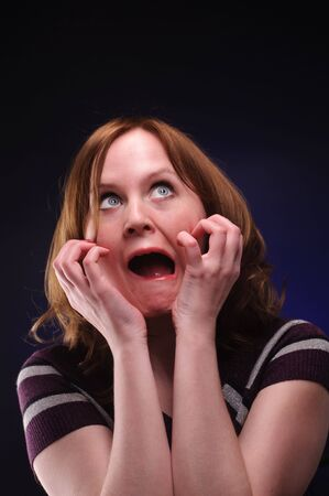 The scared woman over color background Stock Photo - 6547037