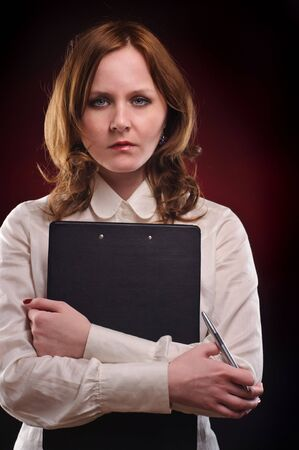 Seriuos businessswoman over dark red background Stock Photo - 6587620