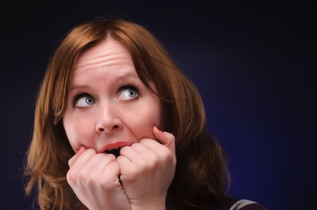 The scared woman over color background. Focused on arms. Stock Photo - 6587667
