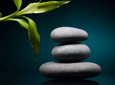Stack of spa stones over color background Stock Photo - 6669875