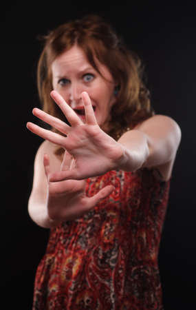 Woman gesturing stop sign. Focus on arm. photo