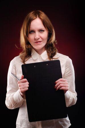 Businesswoman over dark red background photo