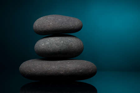 Stack of spa stones over color background Stock Photo - 6900401