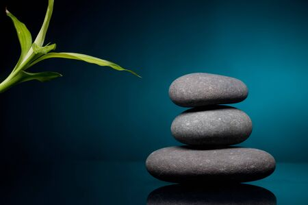 Stack of spa stones over color background photo