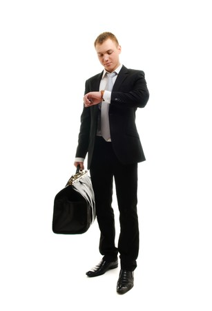 watch over: Young businessman checking his watch. Isolated over white