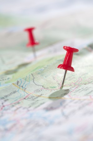 Travel concept with red pushpin photo