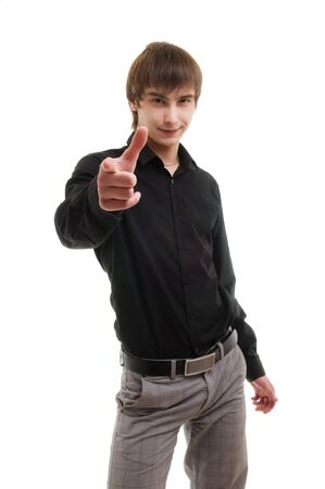 Young man pointing at camera. Isolated over white. Stock Photo - 7505123