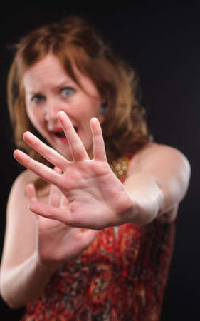 Woman gesturing stop sign. Focus on arm. Stock Photo - 7704659