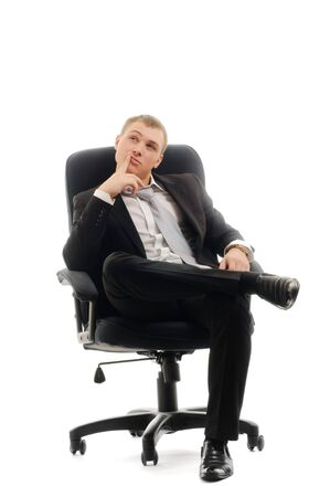 man in chair: Young man sitting in chair. Isolated over white. Stock Photo