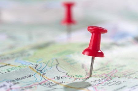 map pin: Travel concept with red pushpin Stock Photo