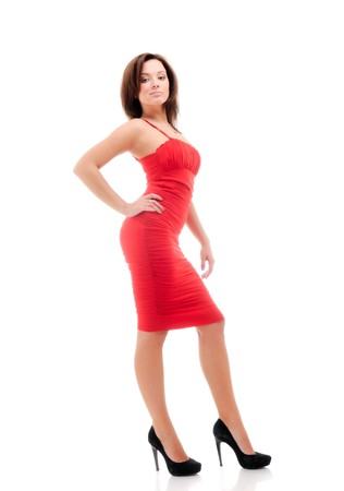 Woman in red dress. Isolated over white. photo
