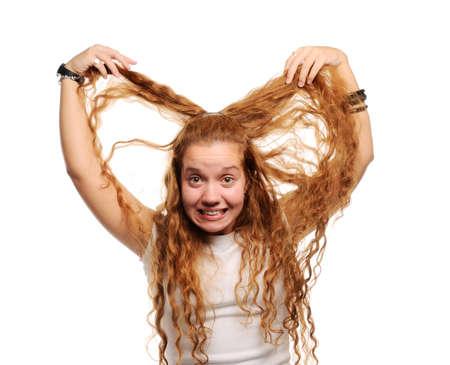Cute ginger girl holding her long hair photo