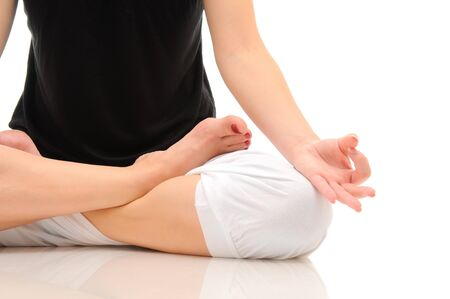 Woman doing yoga isolated over white photo