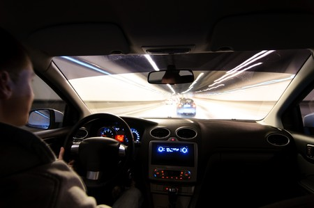 Night road. View from inside car. Natural light. Street and other cars is motion blurred. Stock Photo - 7944598