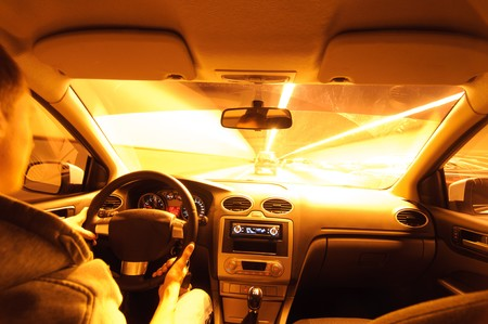 Night road. View from inside car. Natural light. Street and other cars is motion blurred. Stock Photo - 7944597