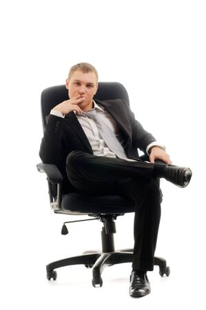 Young man sitting in chair. Isolated over white. photo