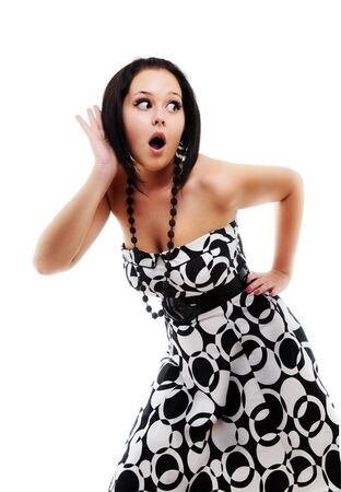 Woman surprised with something heard. Isolated over white. photo