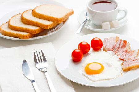 English breakfast with egg, bakon and tomatoes photo