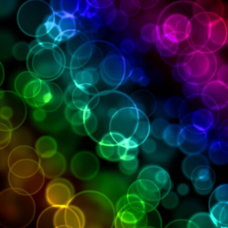 Multicolored bokeh over dark background photo