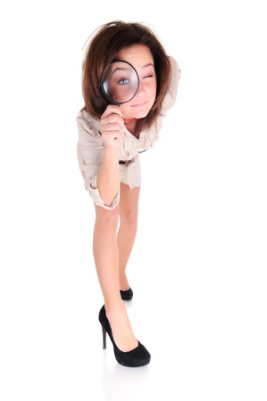 Young woman with magnifying glass photo