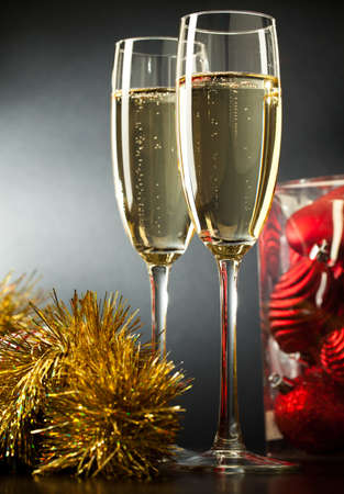 Two full glasses of champagne over gray background Stock Photo - 8309671