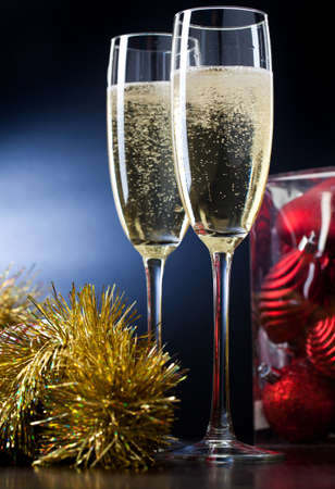 Two full glasses of champagne over gray background photo