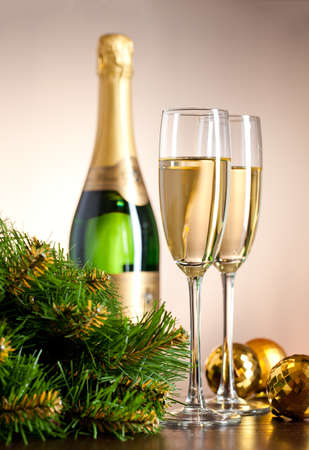 Two full glasses of champagne over color background Stock Photo - 8309672