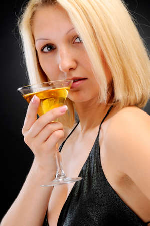 Sexy blonde with goblet near lips photo