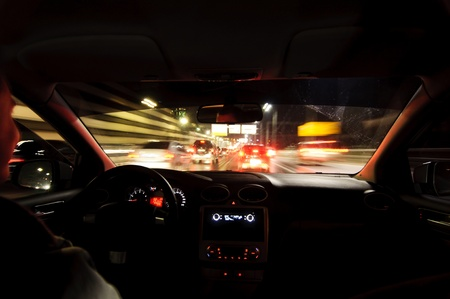 Night road. View from inside car. Natural light. Street and other cars is motion blurred. Stock Photo - 8309715