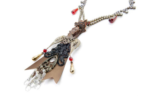 reg: Original necklace with woman, head made of metal and dress made of reg with beads