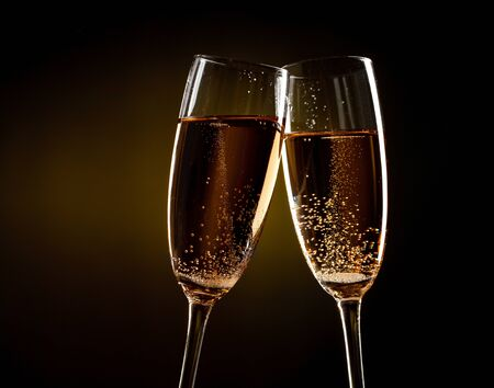 flutes of champagne over yellow background photo