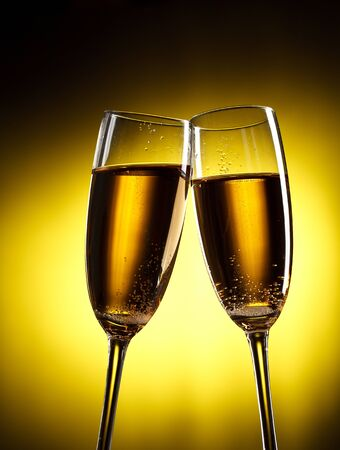 flutes of champagne over yellow background Stock Photo