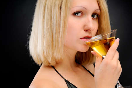 Sexy blonde drinking photo