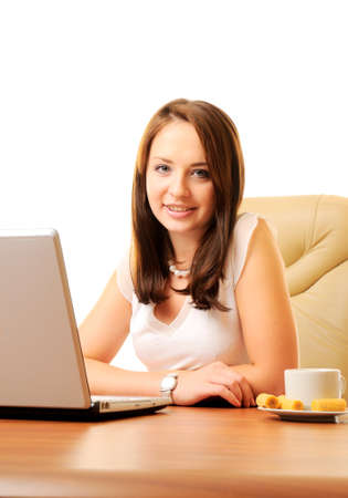 Young beautiful businesswoman with laptop isolated over white photo