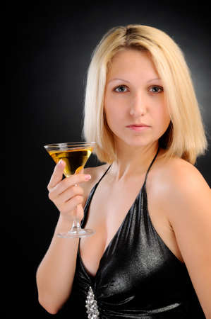 Sexy blonde holding goblet in hand photo