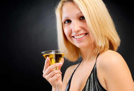 Sexy smiling blonde standing with goblet photo