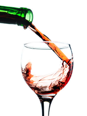 Red wine pouring in glass. Isolated over white Stock Photo - 8616331