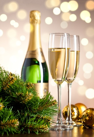 champagne flute: Two full glasses of champagne over color background