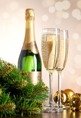gold flute: Two full glasses of champagne over color background