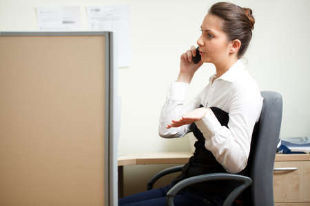 Woman talking over the phone in the office Stock Photo - 8617823