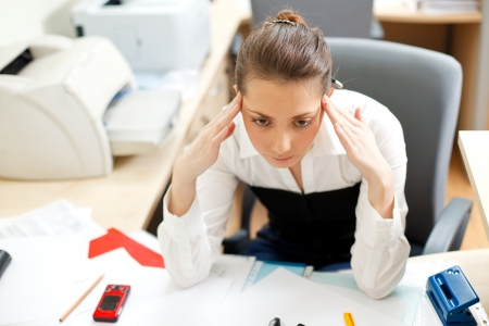 Office life. Tired young woman Stock Photo - 8617681