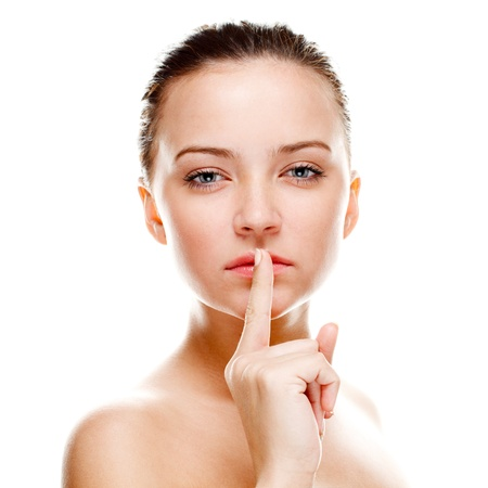 Beautiful woman making silence sign. Isolated over white. Focused on finger Stock Photo - 8616773