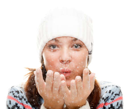 Beautiful woman blowing snow.  isolated over white Stock Photo - 8617102