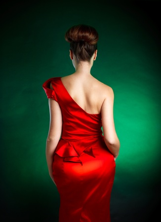 Picture of womans back with stylish red dress
