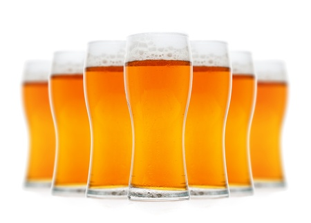 Glasses of  beer isolated over white photo