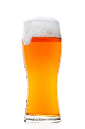Glass of classic beer isolated over white photo