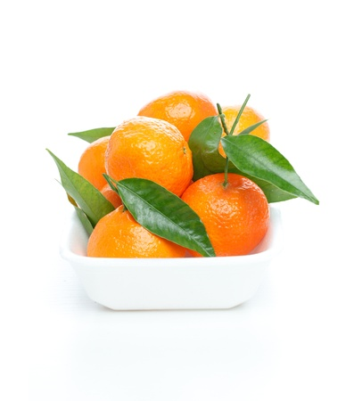 Tangerines with leaves isolated over white Stock Photo - 8995821
